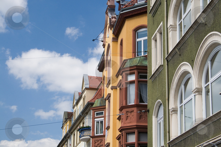 Colorful European Houses stock photo, Colourful European houses on a beautiful summer day, shot against the blue-white sky, a symbol of Bavaria in Germany, where this photo was shot. by Holger Feroudj