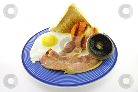 Bacon and Egg Breakfast on a Blue Plate stock photo, Slices of crispy pork bacon with half a grilled tomato a fried egg and a mushroom on a blue round plate with a white background by Keith Wilson