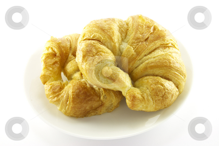 Two Croissants on a White Plate stock photo, Two golden flakey delicious baked croissants on a white plate with a white background by Keith Wilson