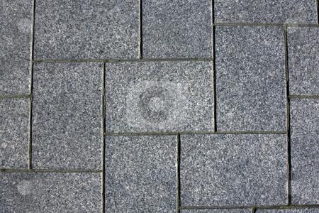 Granite pavement stock photo, Blue granite brick pavement in a herringbone pattern by Darren Pattterson