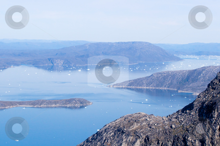 Icerbergs in fjord system stock photo, Icerbergs in fjords of Nuuk, Greenland seen from the top of Sermitsiaq mountain by Anders Peter