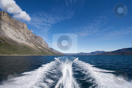 Stern wave from boat stock photo, Stern wave from boat sailing through a fjord in Greenland by Anders Peter