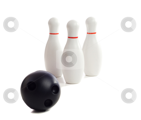 Bowling stock photo, A plastic bowling ball rolling towards three pins, isolated against a white background by Richard Nelson