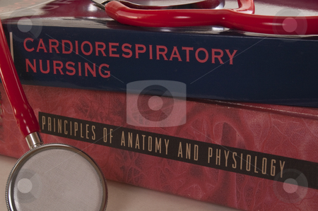 Textbooks and stethoscpe stock photo, A pair of medical / nursing textbooks with a stethoscope. by Jeff Carson