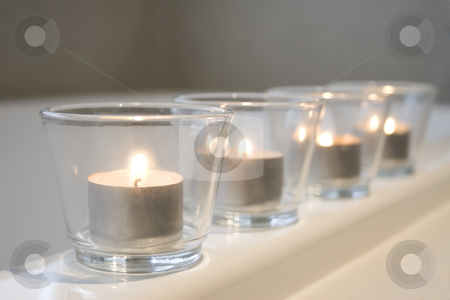 Tealight candles on the bathtub stock photo, Tealight candles on the edge of a bathtub by Jodie Johnson