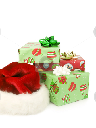 Presents with Santa Hat stock photo, Presents with Santa hat on a white background by John Teeter