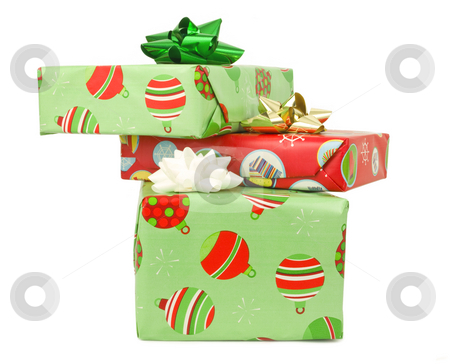 Wrapped presents stock photo, Wrapped presents stacked on a white background by John Teeter