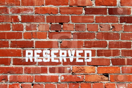 Brick Wall Reserved stock photo, Red bricks wall with an ordinary pattern as a background by Henrik Lehnerer