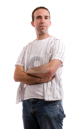 Casual Stance stock photo, A young man dressed in casual clothing is standing with his arms crossed, isolated against a white background by Richard Nelson
