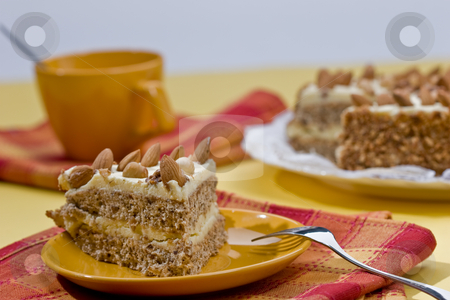 Cake stock photo, Cake with almonds and nut on the yellow plate by Gennady Kravetsky