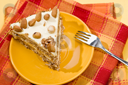 Nut cake stock photo, Cake with almonds and nut on the yellow plate by Gennady Kravetsky