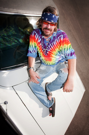 Hippie on a car Hood stock photo, Hippie on the Hood of an old Car by Scott Griessel