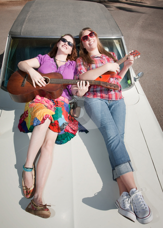 Female Musicians stock photo, Female Musicians on an Old Car by Scott Griessel