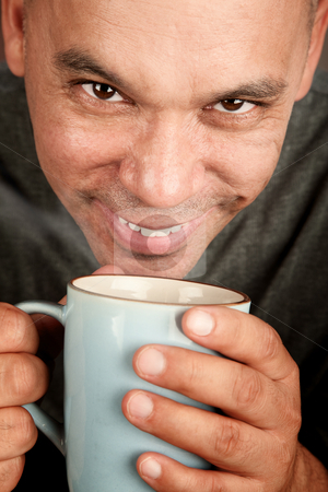 Handsome blonde man with coffee stock photo, Handsome blonde man holding mug of coffee by Scott Griessel