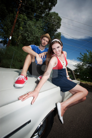 Hipster Couple stock photo, Hipster Couple Sitting on an Old Car by Scott Griessel