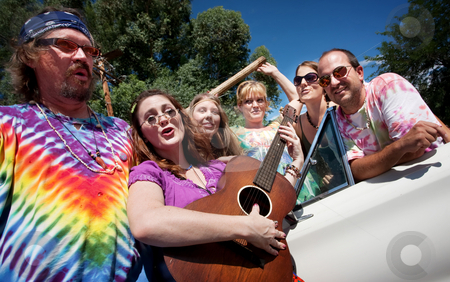 Singing Groups of Friends stock photo, Group of hippies with female guitar player by Scott Griessel