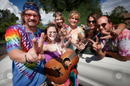 Groovy Group Making Peace Signs stock photo, Group of hippies making peace signs by Scott Griessel