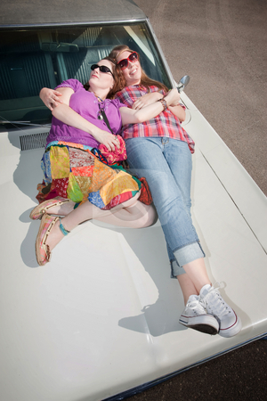 Sleeping Women stock photo, Sleeping women on an old car hood by Scott Griessel