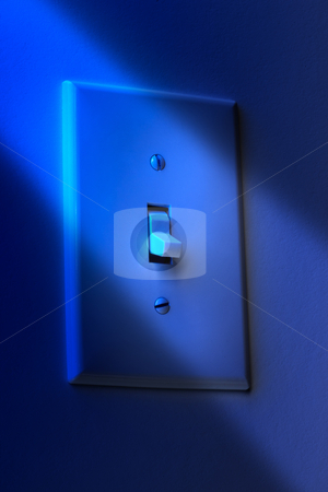 Good night! stock photo, Close up of dramatically lit electric wall switch in