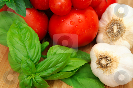 Basil And Tomatoes stock photo, Fresh herbs and vegetables to make spaghetti sauce, including tomatoes, basil, oregano and garlic. by Lynn Bendickson