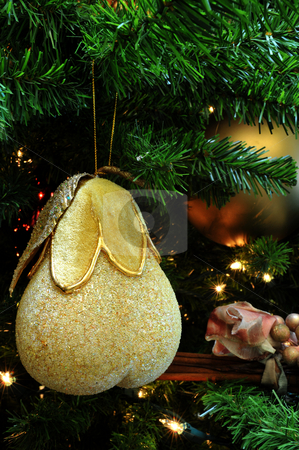 Chritmas Tree Ornamemt stock photo, Finely detailed christmas tree decoration shaped like a pear with small lights in the background by Lynn Bendickson