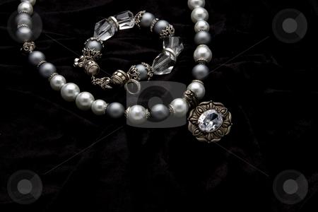 Costume Juwelery stock photo, Silver designer costume jewelery on black velvet background by Adriaan Van den Berg