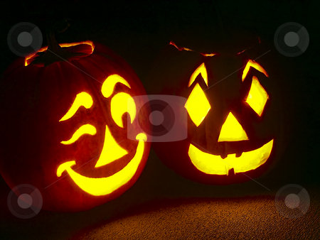 Pumpkin Pair stock photo, Two pumpkin jack-o-lanterns, one winking, sit on a porch. by Kenneth Keifer