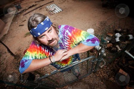 Hippie leaning on a gate stock photo, Colorful hippie leaning on a gate by Scott Griessel