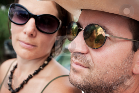 Couple wearing sunglasses stock photo, Attractive adult couple wearing fashionable sunglasses by Scott Griessel