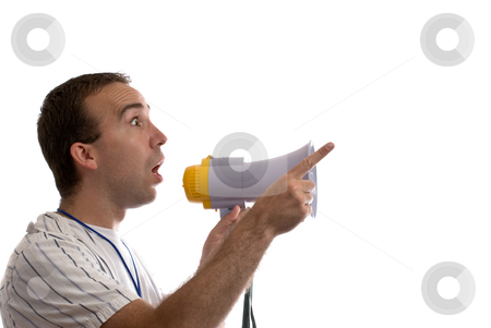 Announcement stock photo, A young man holding a blowhorn and pointing at white copyspace by Richard Nelson