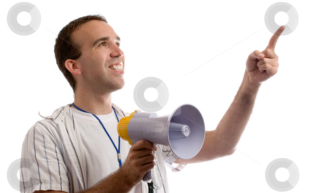Sports Coach stock photo, A young man holding a megaphone and pointing at white copyspace by Richard Nelson