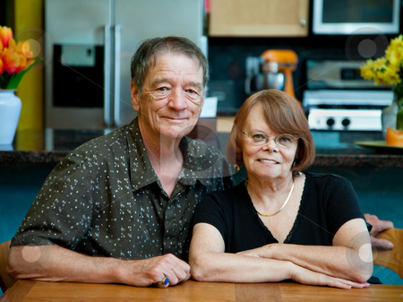 Senior Couple at Home stock photo, Happy senior couple at home in modern kitchen by Scott Griessel