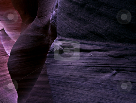 Transitions stock photo, Subtle shades of lavendar transition within the depths of Antelope Canyon by Mike Dawson