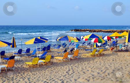Sunbeds and beach umbrellas stock photo, Travel photography: summer: sunbeds and umbrellas in mediterranean beach. by Fernando Barozza