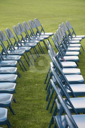 Rows of blue chairs stock photo, Rows of blue chairs on green grass background by Stacy Barnett