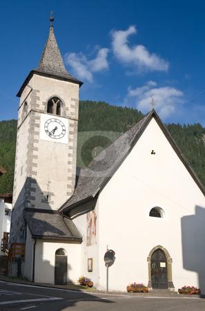 Church in Canazei stock photo, Small church in Canazei, Trentino, Italy. Canazei is a famuos small town in val di Fassa, Italian dolomites. Photo taken with polarizer filter by ANTONIO SCARPI