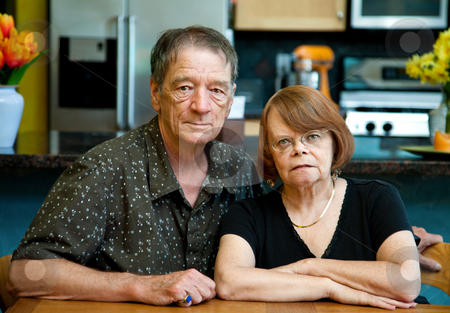 Senior Couple at Home stock photo, Senior couple at a table in their modern kitchen by Scott Griessel