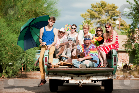 Groovy Group in the Back of Truck stock photo, Portrait of Groovy Group in the Back of Truck by Scott Griessel