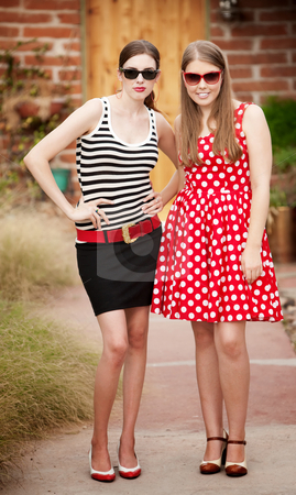 Fashion Girls stock photo, Fashion Girls on Walkway in front of House by Scott Griessel