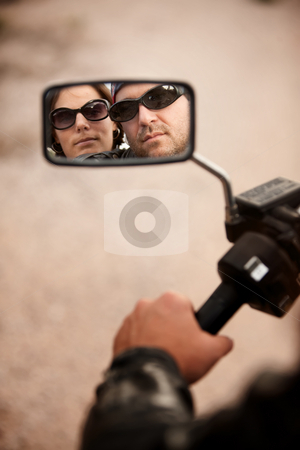 Motorcyclist and Woman Reflection stock photo, Reflection of Motorcycle Driver and Rider in Rearview Mirror by Scott Griessel