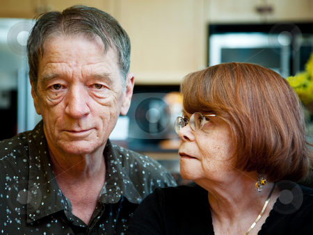 Senior Couple at Home stock photo, Worried Senior Couple at Home in Modern  Kitchen by Scott Griessel