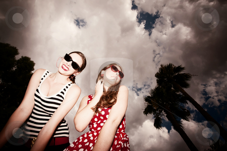 Fashion Girls Against a Cloudy Sky stock photo, Fashion Girls on a Stormy Day Against Cloudy Sky by Scott Griessel