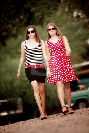 Fashion Girls stock photo, Fashion Girls Walking on Dirt Road Towards Camera by Scott Griessel