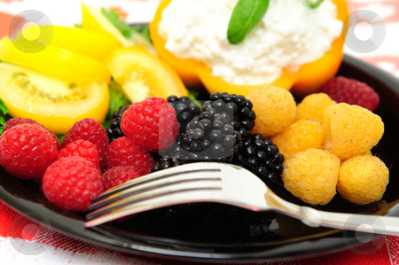Low Calorie Berry Salad stock photo, Lo-cal salad made with red and golden raspberries, blackberries, yellow heirloom tomatoes with an orange bell pepper filled with cottage cheese topped with fresh basil by Lynn Bendickson