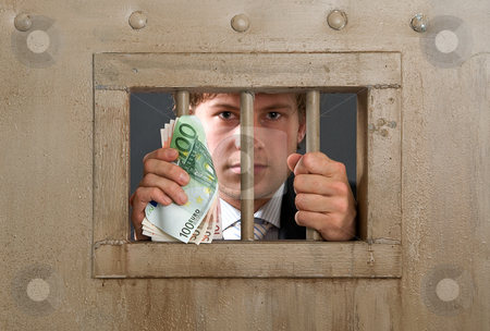 White collar criminal stock photo, White collar criminal in jail for fraud, holding the bars with a substantial amount of cash in his hands by Corepics VOF