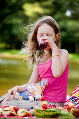 Drinking some juice stock photo, Teenagers having a great time in the park by Frenk and Danielle Kaufmann