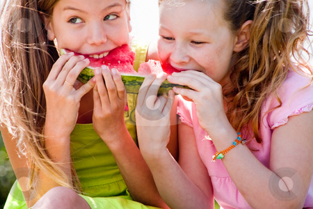 Watermelon fight stock photo, Teenagers having a great time in the park by Frenk and Danielle Kaufmann