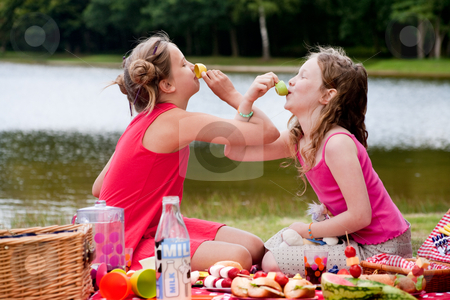 Playing high tea stock photo, Teenagers having a great time in the park by Frenk and Danielle Kaufmann