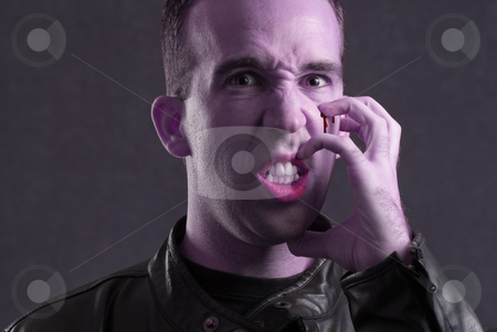 Frustration stock photo, A scary halloween image of a blue man digging his fingers into his face and making himself bleed, because he is frustrated by Richard Nelson