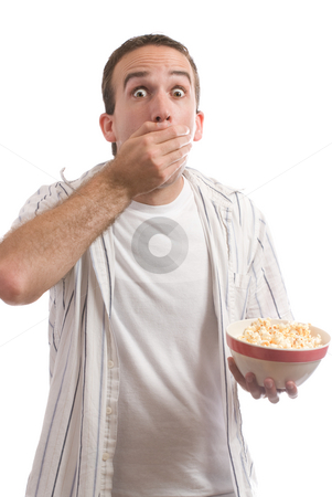 Man Eating Popcorn stock photo, A man eating handfulls of popcorn from a bowl, isolated against a white background by Richard Nelson